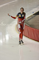 Calgary - December 5, 2009 - Essent ISU World Cup Speedskating at the Olympic Oval in Calgary.  Kristina Groves of Canada waves to the crowd after winning the Gold Medal in the A Division of the women's 1500m event.  Groves finished 1st in 1:54.35 and was part of a strong Canadian contingent that took 3 of the top 4 places in the event...©2009, Sean Phillips.http://www.Sean-Phillips.com