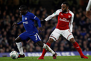 Ngolo Kante of Chelsea (L) avoids a challenge from Alexandre Lacazette of Arsenal (R). Carabao Cup , semi final 1st leg match, Chelsea v Arsenal at Stamford Bridge in London on Wednesday 10th January 2018.<br /> pic by Steffan Bowen, Andrew Orchard sports photography.