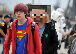 © Licensed to London News Pictures. 30/10/2011. London, UK. Two boys, one wearing a Superman T shirt and the other a pixelated face mask outside the centre. The London Comic Con today, 30th October 2011 as fans of comics, computer games and Sci-Fi movies,  dress up as some of their favourite characters. The London MCM Expo takes place on 28-30th October 2011 at the excel centre in London.  Photo: Stephen Simpson/LNP