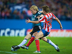 MADRID, SPAIN - Wednesday, October 22, 2008: Liverpool's Dirk Kuyt and Club Atletico de Madrid's Ignacio Camacho during the UEFA Champions League Group D match at the Vicente Calderon. (Photo by David Rawcliffe/Propaganda)