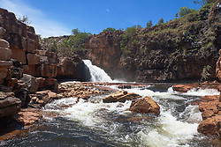 Floodwater flows into Ruby Falls in Red Cone Creek in the Kimberley wet season.