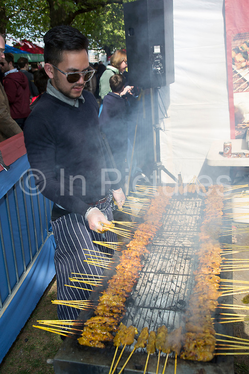 Cooking street food chicken satay skewers over a barbeque at the Malaysian food festival. The South Bank is a significant arts and entertainment district, and home to an endless list of activities for Londoners, visitors and tourists alike.
