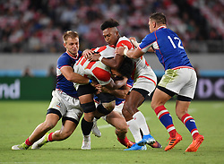 Japan's Kazuki Himeno is tackled by Russia's Kirill Golosnitsky during the Pool A match between Japan and Russia at the Tokyo Stadium, Tokyo, Japan. Picture date: Friday September 20, 2019. See PA story RUGBYU Japan. Photo credit should read: Ashley Western/PA Wire. RESTRICTIONS: Editorial use only. Strictly no commercial use or association. Still image use only. Use implies acceptance of RWC 2019 T&Cs (in particular Section 5 of RWC 2019 T&Cs) at: https://bit.ly/2knOId6