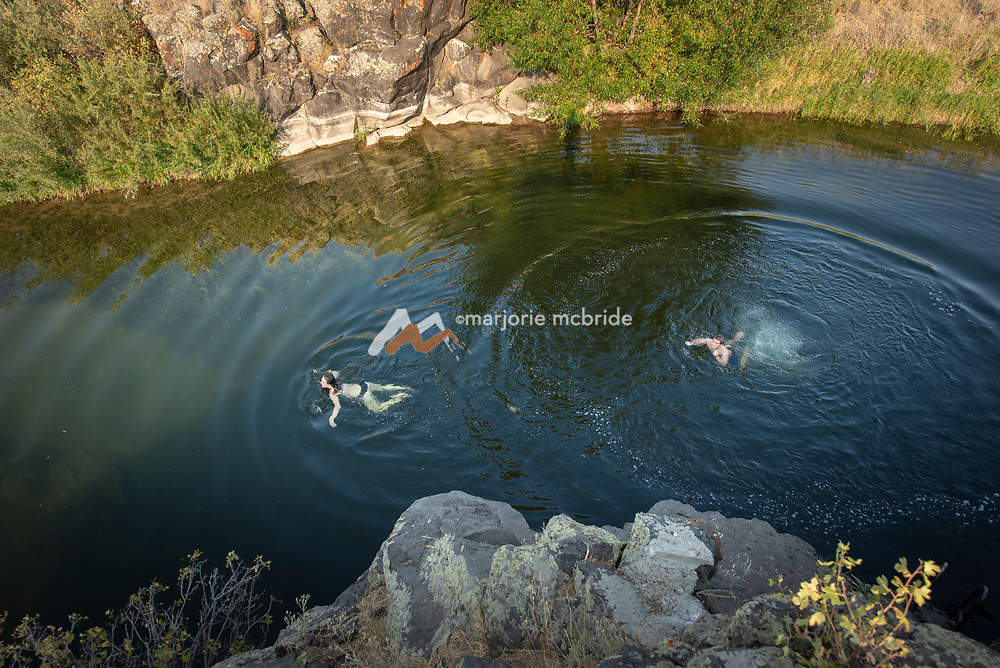 Swimming below the Ledges swimming hole in Richfield, Idaho.