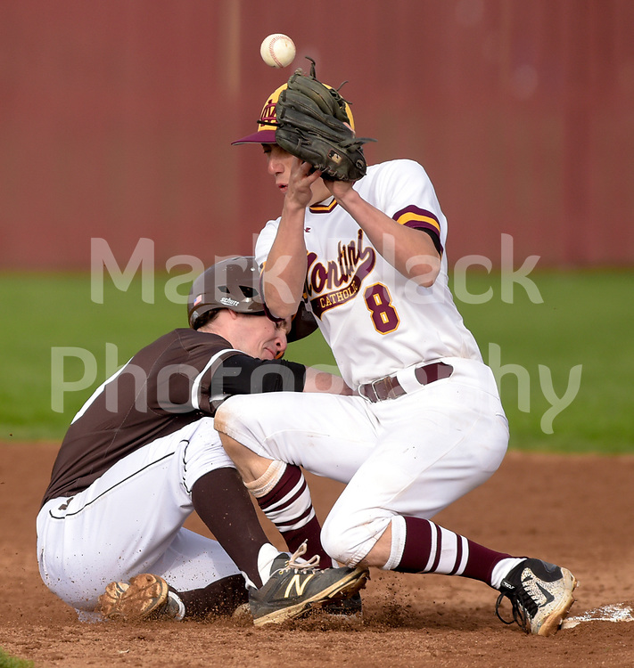 Montini's JR Walsh bobbles the ball allowing Mt. Carmel's Luke to return safely to 2nd, during varsity baseball in Lombard, April 19, 2017.
