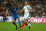 Harry Kane of England is challenged by Jan Durica of Slovakia.  FIFA World cup qualifying match, European group F, England v Slovakia at Wembley Stadium in London on Monday 4th September 2017.<br /> pic by Andrew Orchard, Andrew Orchard sports photography.
