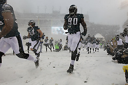 Philadelphia Eagles defensive end Clifton Geathers #90 enters the field with the team before the NFL game between the Detroit Lions and the Philadelphia Eagles on Sunday, December 8th 2013 in Philadelphia. (Photo by Brian Garfinkel)