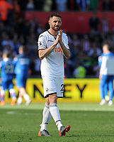 Swansea City's Angel Rangel applauds the fans at the final whistle after seeing Swansea City relegated from the Premier league<br /> <br /> Photographer Ian Cook/CameraSport<br /> <br /> The Premier League - Swansea City v Stoke City - Sunday 13th May 2018 - Liberty Stadium - Swansea<br /> <br /> World Copyright © 2018 CameraSport. All rights reserved. 43 Linden Ave. Countesthorpe. Leicester. England. LE8 5PG - Tel: +44 (0) 116 277 4147 - admin@camerasport.com - www.camerasport.com