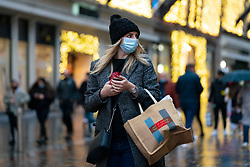 Glasgow, Scotland, UK. 20 November 2020. On the day when the severest level 4 lockdown will be imposed at 6pm, shoppers are out on the streets of Glasgow doing last minute Christmas shopping before the shops close for 3 weeks. Pictured; Women shopping on Buchanan Street.   Iain Masterton/Alamy Live News