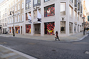 With very few people out and about the scene at Bond Street is one of empty desolation and all shops closed like here at Louis Vuitton, as the national coronavirus lockdown three continues on 28th January 2021 in London, United Kingdom. Following the surge in cases over the Winter including a new UK variant of Covid-19, this nationwide lockdown advises all citizens to follow the message to stay at home, protect the NHS and save lives. Bond Street is one of the principal streets in the West End shopping district and is very upmarket. It has been a fashionable shopping street since the 18th century. The rich and wealthy shop here mostly for high end fashion and jewellery.