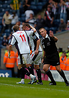 Photo: Leigh Quinnell.<br /> West Brom v Birmingham City. The Barclays Premiership. Zoltan Gera checks Geoff Horsfeild is ok after he fell during his goal for West Brom.<br /> 27/08/2005.