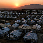 DOHUK, IRAQ - OCTOBER 24: An overview of a section of the Badarash IDPs camp which has continued to swell for Syrian Kurdish refugees fleeing the recent Turkish incursion in Rojava. In seven days UNHCR reports that 7,100 have now arrived on October 24, 2019 in Dohuk, Iraq. Many fleeing have said saying they paid to be smuggled through the Syrian border.  (Photo by Byron Smith/Getty Images)