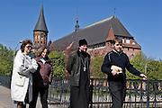 Kaliningrad, Russia, 05/05/2007..A Russian Orthodox priest walks past Koenigsburg Cathedral in Kaliningrad city centre.