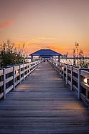 Sunset on a pier along back bay on the Mississippi Gulf Coast