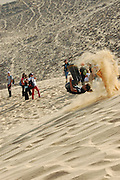 Children Skiing on a sand dune