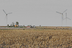 26 April 2008:   A farm is nestled in the side of a hill surrounded by wind turbines that are a part of the Twin Grove wind farm east of Bloomington Illinois..<br /> <br /> This image was produced in part utilizing High Dynamic Range (HDR) or panoramic stitching or other computer software manipulation processes. It should not be used editorially without being listed as an illustration or with a disclaimer. It may or may not be an accurate representation of the scene as originally photographed and the finished image is the creation of the photographer.