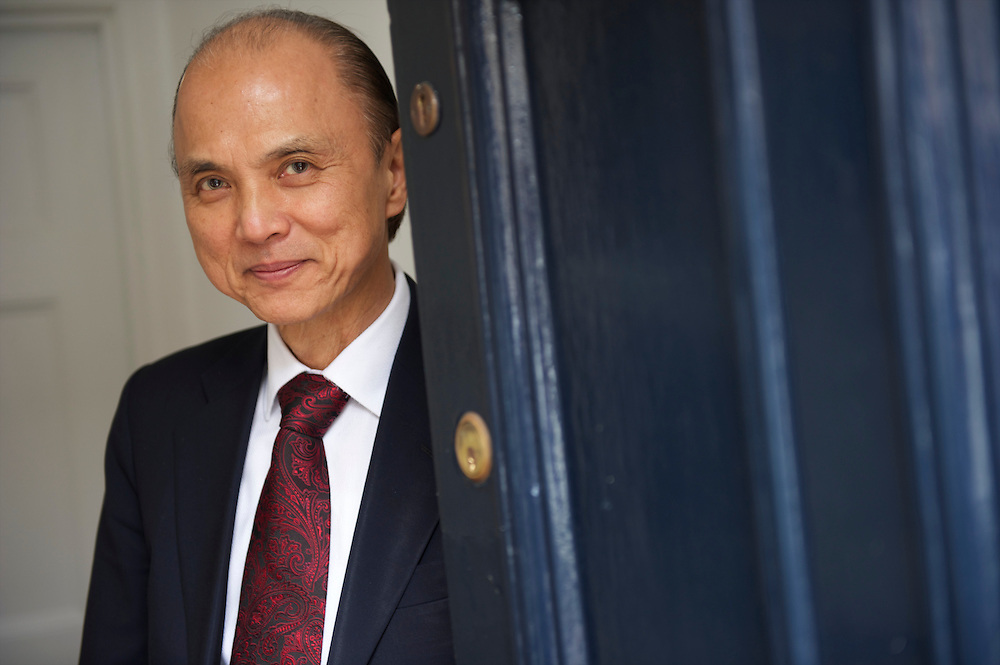 Fashion designer Jimmy Choo poses in his studio on Cannaught Street, London, March 22, 2010