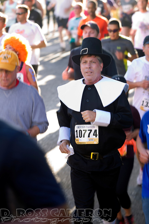 Thomas Hawley of Las Vegas runs costumed as a Pilgrim during the 102nd running of the Bay to Breakers 12K in San Francisco, Sunday, May 19, 2013. More than 30,000 runners -- from the elite to the weekend warrior -- made the 7.62-mile trek from Howard and Spear to the Great Highway. (Photo by D. Ross Cameron)