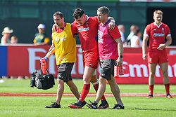 Joe Goodchild of Wales leaves the field with an injury<br /> <br /> Photographer Craig Thomas/Replay Images<br /> <br /> World Rugby HSBC World Sevens Series - Day 2 - Friday 6rd December 2019 - Sevens Stadium - Dubai<br /> <br /> World Copyright © Replay Images . All rights reserved. info@replayimages.co.uk - http://replayimages.co.uk
