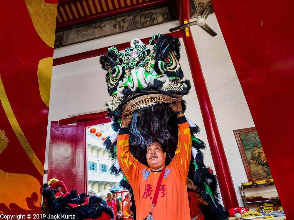 05 FEBRUARY 2019 - BANGKOK, THAILAND: Lion dancers enter Canton Shrine on the first day of Chinese New Year celebrations in Bangkok. Chinese New Year celebrations in Bangkok started on February 4, 2019, although the city's official celebration is February 5 - 6. The coming year will be the Year of the Pig in the Chinese zodiac. About 14% of Thais are of Chinese ancestry and Lunar New Year, also called Chinese New Year or Tet is widely celebrated in Chinese communities in Thailand.       PHOTO BY JACK KURTZ