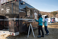Allison and Claire Knab take a lunch break at the Winni Wagon located at the base of the Panorama lift at Gunstock on Friday.  (Karen Bobotas Photo/for The Laconia Daily Sun)