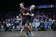 Paul Coll of New Zealand (wearing a Maroon shirt) celebrates after winning a crucial point against James Willstrop of England (wearing a Dark Blue shirt). Canary Wharf Squash Classic 2016 , day two at the East Wintergarden in Canary Wharf , London on Tuesday 8th March 2016.<br /> pic by John Patrick Fletcher, Andrew Orchard sports photography.