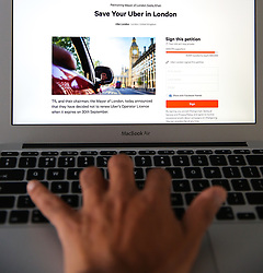 "September 23, 2017 - London, London, United Kingdom - Image ©Licensed to i-Images Picture Agency. 23/09/2017. London, United Kingdom. ..The picture displays the petition page on Change.org showing over 400,000 signatures on a petition to ""Save Your Uber in London"" calling on Transport for London (TfL) to reverse its decision to strip Uber's licence in London. Uber's licence is due to expire on 30 September...Picture by Dinendra Haria / i-Images (Credit Image: © Dinendra Haria/i-Images via ZUMA Press)"