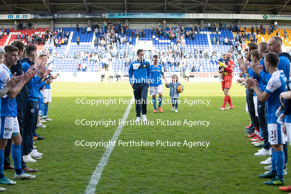 St Johnstone v Ross County…12.05.18…  McDiarmid Park    SPFL<br />Leaving players Steven MacLean, Chris Millar and Alan Mannus are applauded of the pitch by their team mates<br />Picture by Graeme Hart. <br />Copyright Perthshire Picture Agency<br />Tel: 01738 623350  Mobile: 07990 594431