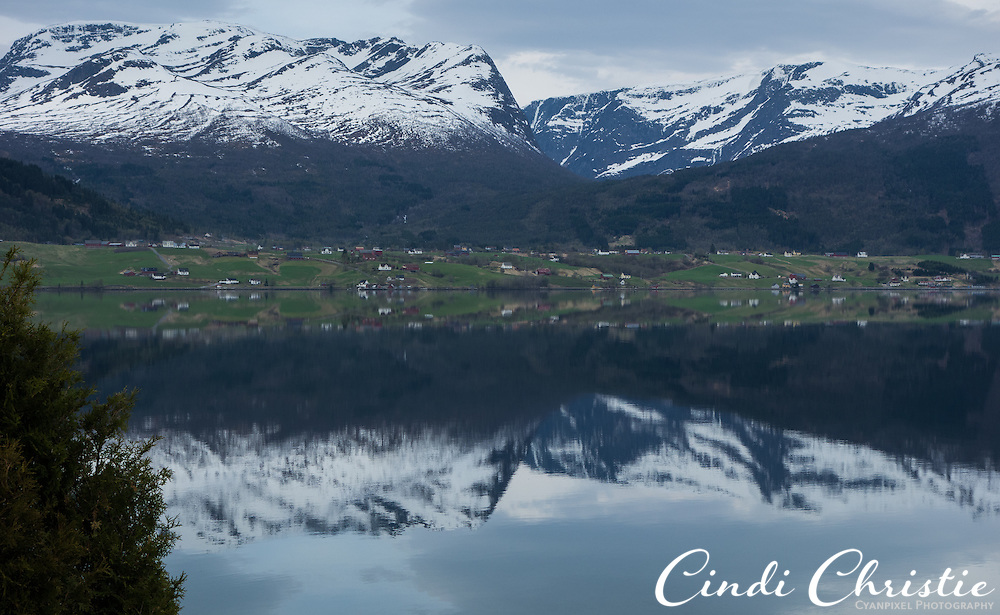 Gloppen fjord is calm on the morning of syttende mai (May 17), or  Nasjonaldagen, in Sandane, Norway. The day will be spent with a morning and afternoon parade separated with a meal of traditional foods. (© 2013 Cindi Christie)