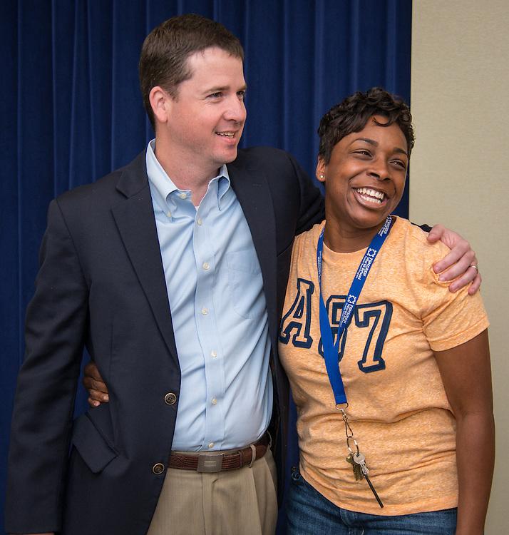 Fondren Middle School principal Monique Lewis, right,  reacts after Andrew Houlihan, left, announces Fondren is awarded the Blue Star School Award for Service Excellence, April 24, 2015.