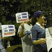 Fans gather for an impromptu celebration outside of Dodger Stadium after it was announced that Frank McCourt, beleagured owner of the storied franchise, would be selling the Los Angeles Dodgers.