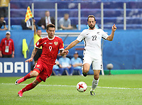 (170618) -- ST. PETERSBURG, June 18, 2017 -- Fedor Smolov (L) of Russia vies with Andrew Durante of New Zealand during the group A match between Russia and New Zealand of the 2017 FIFA Confederations Cup in St. Petersburg, Russia, on June 17, 2017. Russia won 2-0. ) (SP)RUSSIA-ST. PETERSBURG-2017 FIFA CONFEDERATIONS CUP-RUS VS NZL<br /> <br /> <br /> Norway only