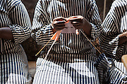 Prison women doing knitting inside Thika Women's Prison. At present there are 6 young children inside the prison that get looked after in a small cell for the day whilst the mothers go to work. Action for children in conflict (AFCIC) provides clothes and resources for the children to play with.