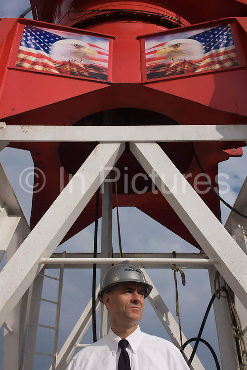 Investigative Engineering Services, Assistant Commissioner Tim Lynch inspecting a new construction site in Manhattan, New York City. Looking out to the NYC skyline, Tim works in the prevention of damage to old and ensuring new buildings are up to standard plus often, assessing the status of a collapsed structure. The bald eagle was chosen June 20, 1782 as the emblem of the United States of American, because of its long life, great strength and majestic looks, and also because it was then believed to exist only on this continent. From the chapter entitled 'The Skyline' and from the book 'Risk Wise: Nine Everyday Adventures' by Polly Morland (Allianz, The School of Life, Profile Books, 2015).