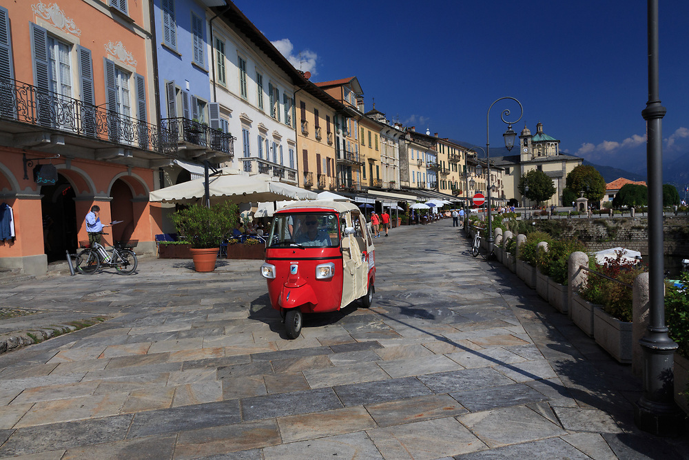 Cannobia on Lago di Maggiore, Italy. Cannobio has one of Lake Maggiore's most elegant promenades with colorful buildings leading to the elegant porticoes with pretty little shops, cafés, and restaurants.