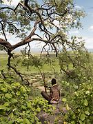 Isak takes a break while hunting. Near the Hadza camp of Dedauko.
