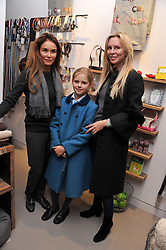 Left to right, CINDY SIU, ANGELINA TAYLOR and her mother CHARMIAN TAYLOR at a party at Mungo & Maud, 79 Elizabeth Street, London to celebrate the launch of a collection of dog accessories designed by Yasmin Le Bon held on 22nd November 2011.
