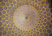 Stunning photographs reveal the beautiful ceilings in Iran's mosques, bazaars and public baths<br /> <br /> For the past few decades, restrictions on travel to Iran has meant the country has been largely shut off from the Western world, butas visa sanctions are lifted in the light of a landmark nuclear deal, the local tourism industry is hoping for a flurry of visitors.<br /> It's not hard to see why Iran is listed as one of the top travel destinations of 2016, with its rich culture and history.<br /> Among the standout aspects of the nation is its beautiful ancient architecture, with the cities and towns littered withornate and eye-catching mosques, public baths and markets.<br /> And unlike many other countries - the roof is not an afterthought, with many ceilings built as the centrepiece to the building, with many of the tile designs showcasing a display of intricate geometric patternsthatdate back several centuries.<br /> French photographerEric Lafforgue has travelled the country photographing the ceilings of indoor markets, mosques and bath houses.<br /> <br /> Photo shows: The ceiling of the dome in Sheikh Lotfollah Mosque. The construction of the ceiling started in 1603 and the decoration seems to lead the eye upwards toward its centre, as the rings of ornamental bands filled with Arabesque patterns become smaller and smaller