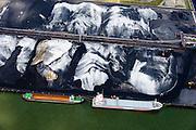 Nederland, Zuid-Holland, Rotterdam, 10-06-2015; Botlek, Sint-Laurenshaven. Coaster en binnenvaartschip voor de kade bij EBS. Overslag van droge bulk<br /> Transhipment of dry bulk (coal).<br /> <br /> luchtfoto (toeslag op standard tarieven);<br /> aerial photo (additional fee required);<br /> copyright foto/photo Siebe Swart