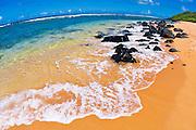 Surf and sand at Larsen's Beach, Island of Kauai, Hawaii USA