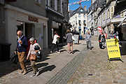 Street scene on 24th September 2021 in Quimper, Brittany, France. Quimper is the ancient capital of Cornouaille, Brittany's most traditional region, and has a distinctive Breton Celtic character. Its name is the Breton word Kemper, meaning confluence. Brittany is a peninsula, historical county, and cultural area in the west of France, covering the western part of what was known as Armorica during the period of Roman occupation. It became an independent kingdom and then a duchy before being united with the Kingdom of France in 1532 as a province governed as a separate nation under the crown.