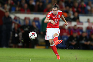 Gareth Bale of Wales © has a shot at goal from a free-kick.. Wales v Moldova , FIFA World Cup qualifier at the Cardiff city Stadium in Cardiff on Monday 5th Sept 2016. pic by Andrew Orchard, Andrew Orchard sports photography