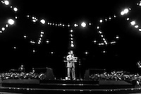 Under the lights from the large domed church, California Governor Arnold Schwarzenegger addresses the members at church services at Crenshaw Christian Center in Los Angeles, Sunday Sept. 17, 2005.