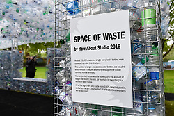 "© Licensed to London News Pictures. 24/05/2018. LONDON, UK.  Unveiling of an art installation called ""Space of Waste"" by architect Nick Wood, in ZSL London Zoo.  The artwork comprises a building made of 15,000 discarded single-use bottles collected from London and its waterways and is part of ZSL's #OneLess campaign, aiming to protect the world's oceans by encouraging people to stop using single-use plastic bottles.  Photo credit: Stephen Chung/LNP"