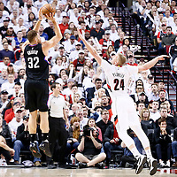 `25 April 2016: Los Angeles Clippers forward Blake Griffin (32) takes a jump shot over Portland Trail Blazers center Mason Plumlee (24) during the Portland Trail Blazers 98-84 victory over the Los Angeles Clippers, during Game Four of the Western Conference Quarterfinals of the NBA Playoffs at the Moda Center, Portland, Oregon, USA.