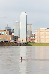 Partially submerged stop-sign in Trinity River at flood stage, Dallas, Texas, USA