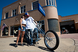 Event organizer JP Rodman and Amber Leshay with JP's custom Harley-Davidson Panhead trike in front of his shop after his Run to Raton. Raton, NM. USA. Sunday July 22, 2018. Photography ©2018 Michael Lichter.