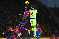 Dejan Lovren of Liverpool heads the ball over Christian Benteke of Crystal Palace. Premier League match, Crystal Palace v Liverpool at Selhurst Park in London on Saturday 29th October 2016.<br /> pic by John Patrick Fletcher, Andrew Orchard sports photography.
