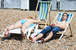 © Licensed to London News Pictures. 29/06/2015. Brighton, UK. People take advantage of the start to the expected hottest day of the year so far by relaxing and sunbathing on Brighton beach, today June 29th 2015. Photo credit : Hugo Michiels/LNP