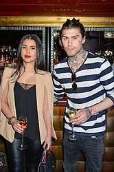MARCO PIERRE WHITE jnr and GHAZ HADIAN at a party to celebrate the UK launch of French fashion label ba&sh at The Arts Club, Dover Street, London on 15th March 2016.